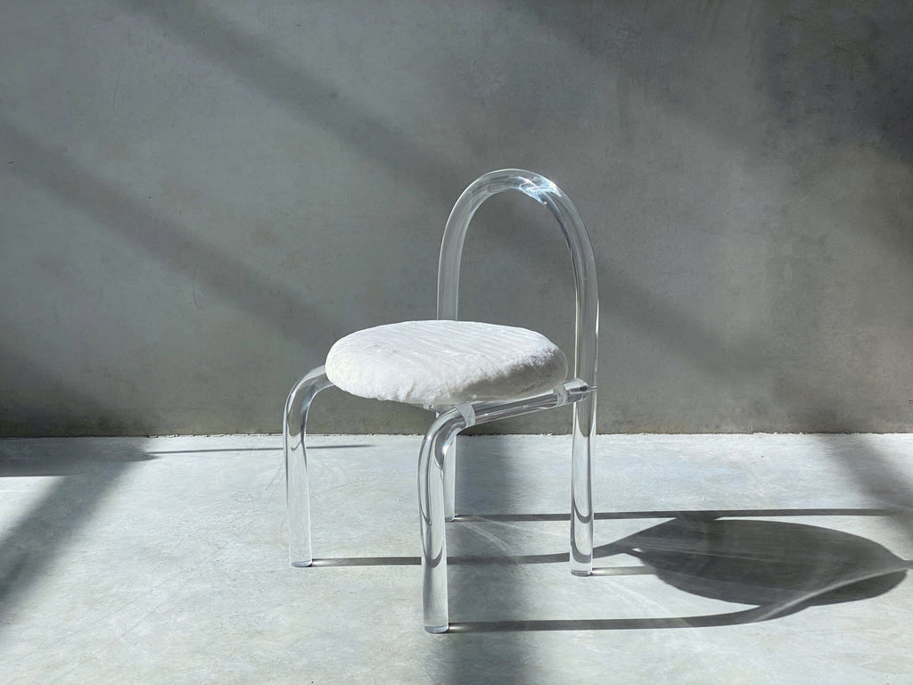 Daisy Chair. Lucite frame. White fur upholstery.
