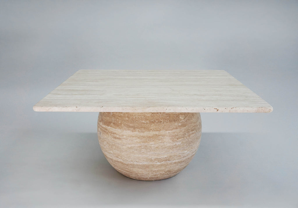 Alunir Coffee Table. Solid round travertine base. Smooth square travertine tabletop.