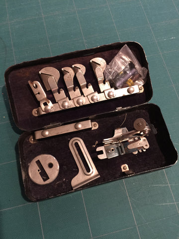 Metal box of sewing machine attachments