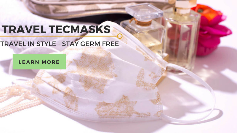 Travel TECMASKS travel in style -stay germ free, disposable face mask with perfume, flowers and purse in the background