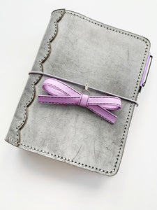 The Carolyn Goth Leather Bow Planner Charm in Purple