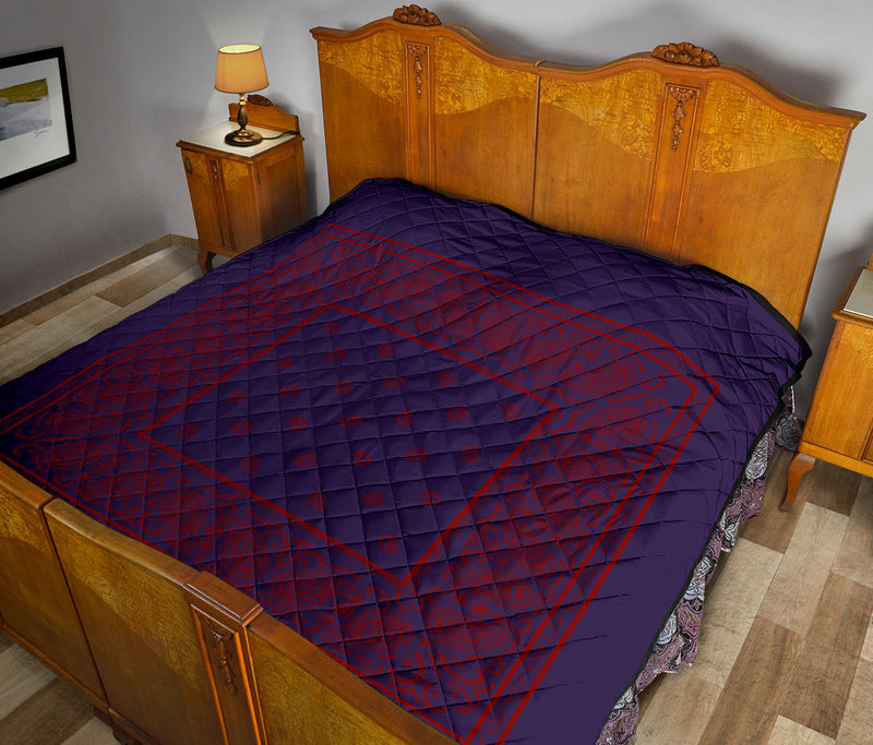purple and red bedding quilt