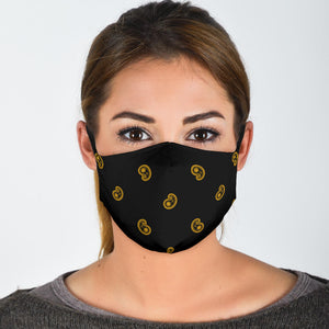 black and gold face mask with paisley pattern