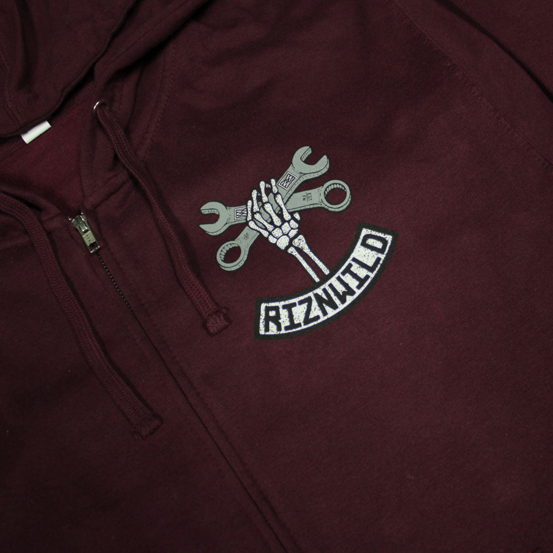 RIZNWILD | Wrench Twist logo left chest on a zip up sweatshirt
