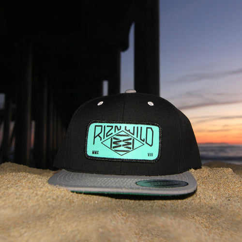RIZNWILD | Snapback hat on the beach under the pier mint patch color