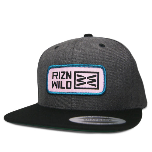 RIZNWILD snapback hat with pink and teal patch