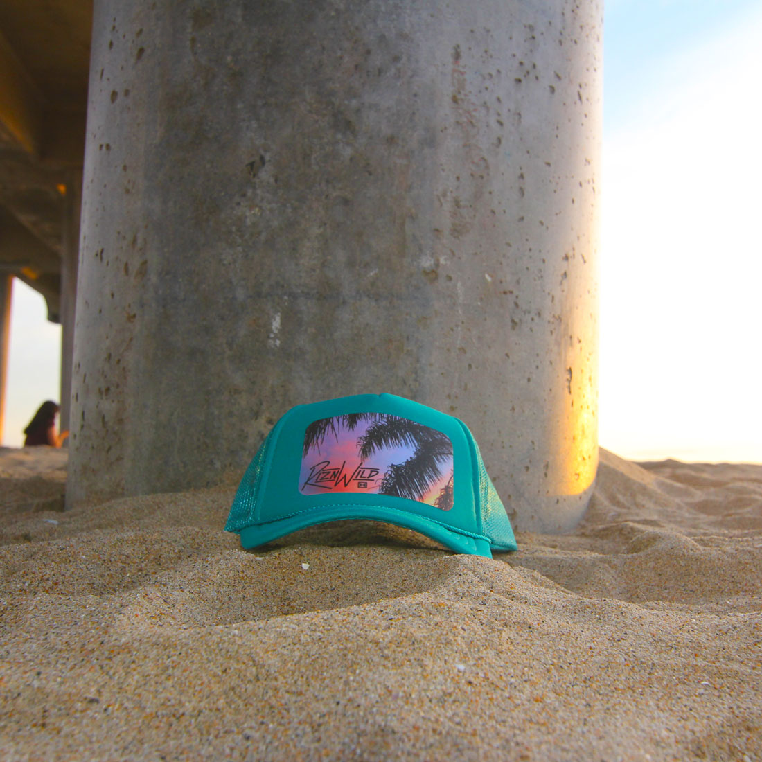 Sunset Youth Curved Bill Trucker Hat in Turquoise