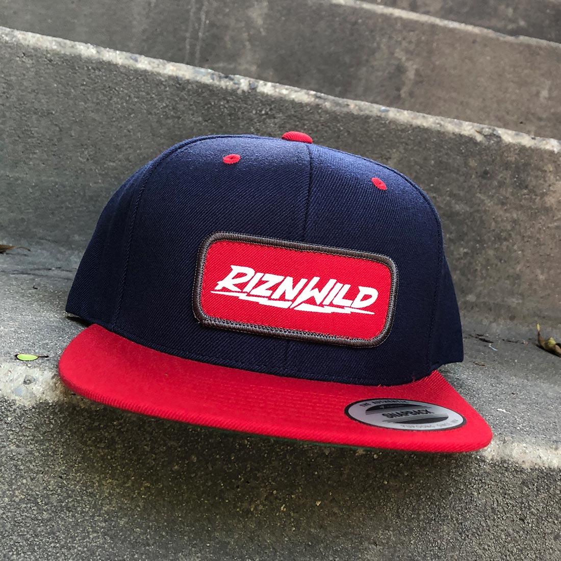 RIZNWILD | Red White and Grey patch on a flex fit hat