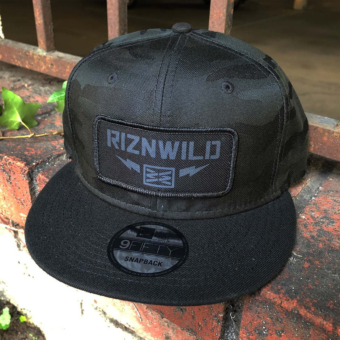 RIZNWILD | Camo new era hat with patch sewn on front