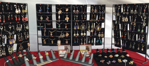 Views of earrings and necklaces on cards displayed on the wholesale racks