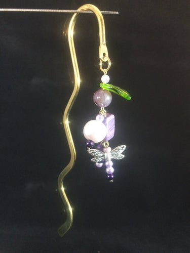 A brass hook type bookmark adorned with gemstone beads, glass beads, glass pearls, and a metal dragon fly charm.