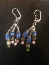 Load image into Gallery viewer, Three silver plated beads that change color with temperature sit on a three silver plated chains below silver plated brass leverbacks.
