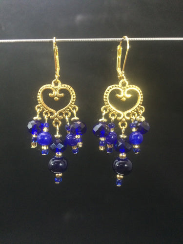 These chandelier-styleåÊleverbackåÊearrings featureåÊa heart-shaped, plated base metalåÊcentral focal, withåÊa mixture of blue faceted glass beads and colored glass pearls.