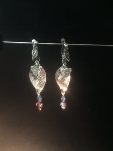 Leverback earrings made with plated metal charms and glass beads (faceted beads and glass pearls)