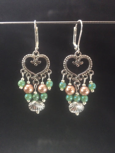 Leverback chandelier earrings made with glass pearls, metal beads, and metal shell charms.