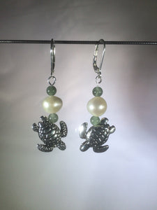 Metal beads shaped like diving sea turtles are accented by aventurine and glass pearl beads in these silver plated brass leverback drop earrings.