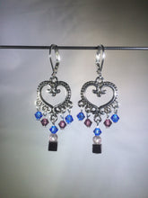 "Load image into Gallery viewer, Blue glass and Czech crystal beads dangle from a central brass heart focal in these 1.25"" drop brass chandelier leverback earrings."