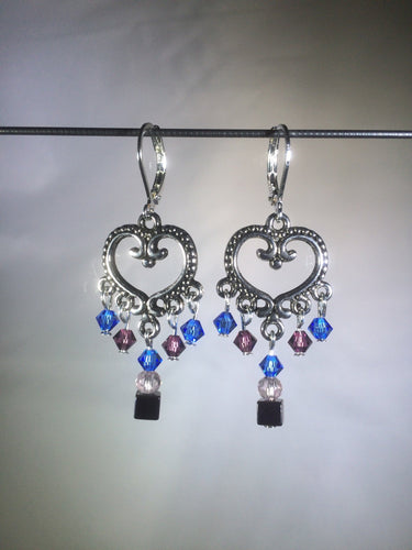 Blue glass and Czech crystal beads dangle from a central brass heart focal in these 1.25