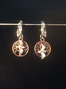 These leverback earrings feature a single bird over a tree. They form a matching set with 1NCK0028.