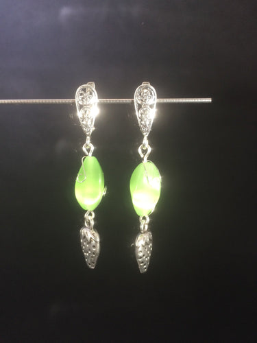 Tiny metal strawberry charms dangle from chatoyant green glass beads below silver plated brass leverbacks in these 1.5