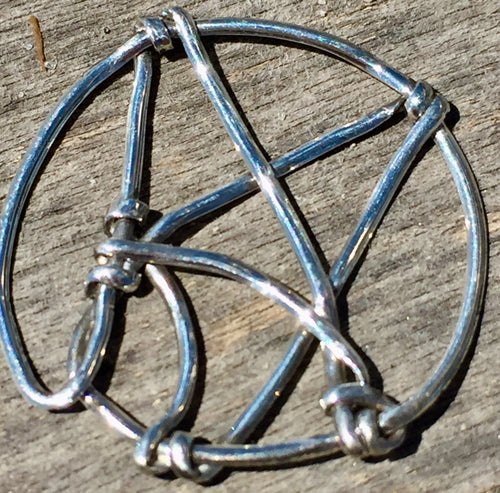 The logo for Atheist Alliance International is depicted in sterling silver in this wire wrap pendant, set onto a 16