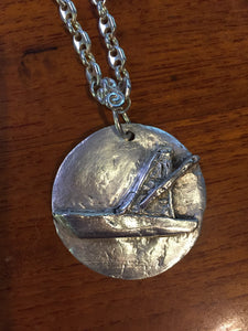 This fine silver pendant is molded to depict a specific make and model of boat. Part of our custom boat portraist series, this piece shows our capability to manufacture a pendant bespoke to a specific vessel. Details are taken from photographs and boat plan drawings. Any vessel can be portrayed--come visit our special section at https://www.kalmansoncreations.com/boats on our independent website for more information!