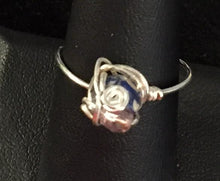 Load image into Gallery viewer, A 6mm reconstituted and dyed shell round bead is set with a swirl and a purple glass seed bead into this sterling silver wire wrapped ring. Rings made by this wire wrapping method vary individually. This one is approxmately a size 8.