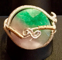 Load image into Gallery viewer, Fine silver and vermeil (14K gold plating over sterling silver) wire ensconce a faceted lentil shaped bead of natural watermelon tourmaline. Rings made by this wire wrapping method vary individually. This one is approxmately a size 11, but may fit a slightly larger finger depending on how snug a fit you prefer.