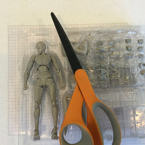 Here is a COLOR-LILIJ manikin set showing its relative size against a scissor
