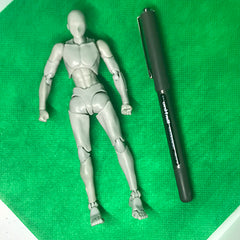 Sketch manikin compared to a pen