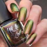 """Bronzewing Fling"" a multichrome nail polish from Hit the Bottle. Shifts from a rosy copper, to gold to a brilliant green."