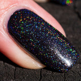 holo-topcoat-over-black-in-sun-macro-one-nail