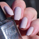holo-topcoat-over-pale-pink-in-sun-angle
