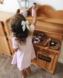 Playing house Little girl with Wooden play kitchen