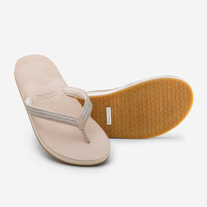 Hari Mari Women's Fields Puebla flip flops in sand showing flip flop and bottom of flip flop rubber outsole on white background