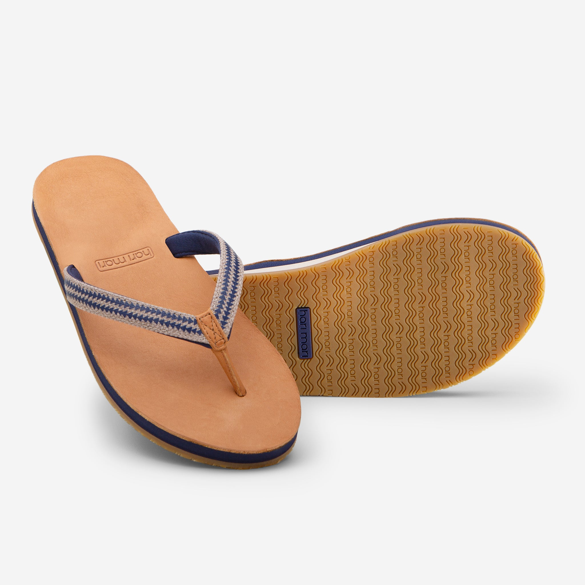 Hari Mari Women's Fields Puebla flip flops in wheat/navy on white background showing flip flop and bottom of flip flop rubber outsole