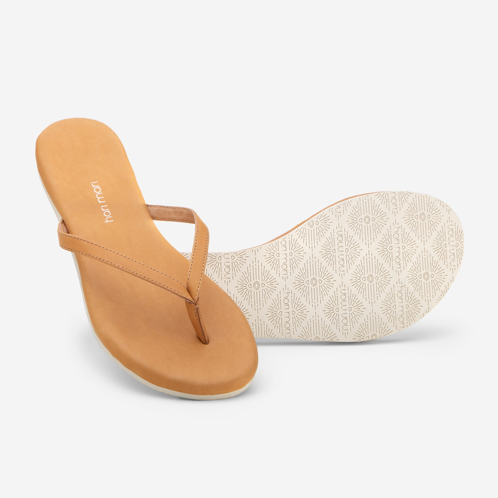 Hari Mari Women's The Mari Flip Flop in Natural  on white background showing flip flop and bottom of flip flop rubber outsole