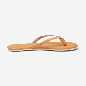 side profile of Hari Mari Women's The Mari Flip Flop in Natural  on white background