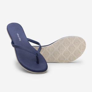 Hari Mari Women's The Mari Flip Flop in Navy on white background showing flip flop and bottom of flip flop rubber outsole