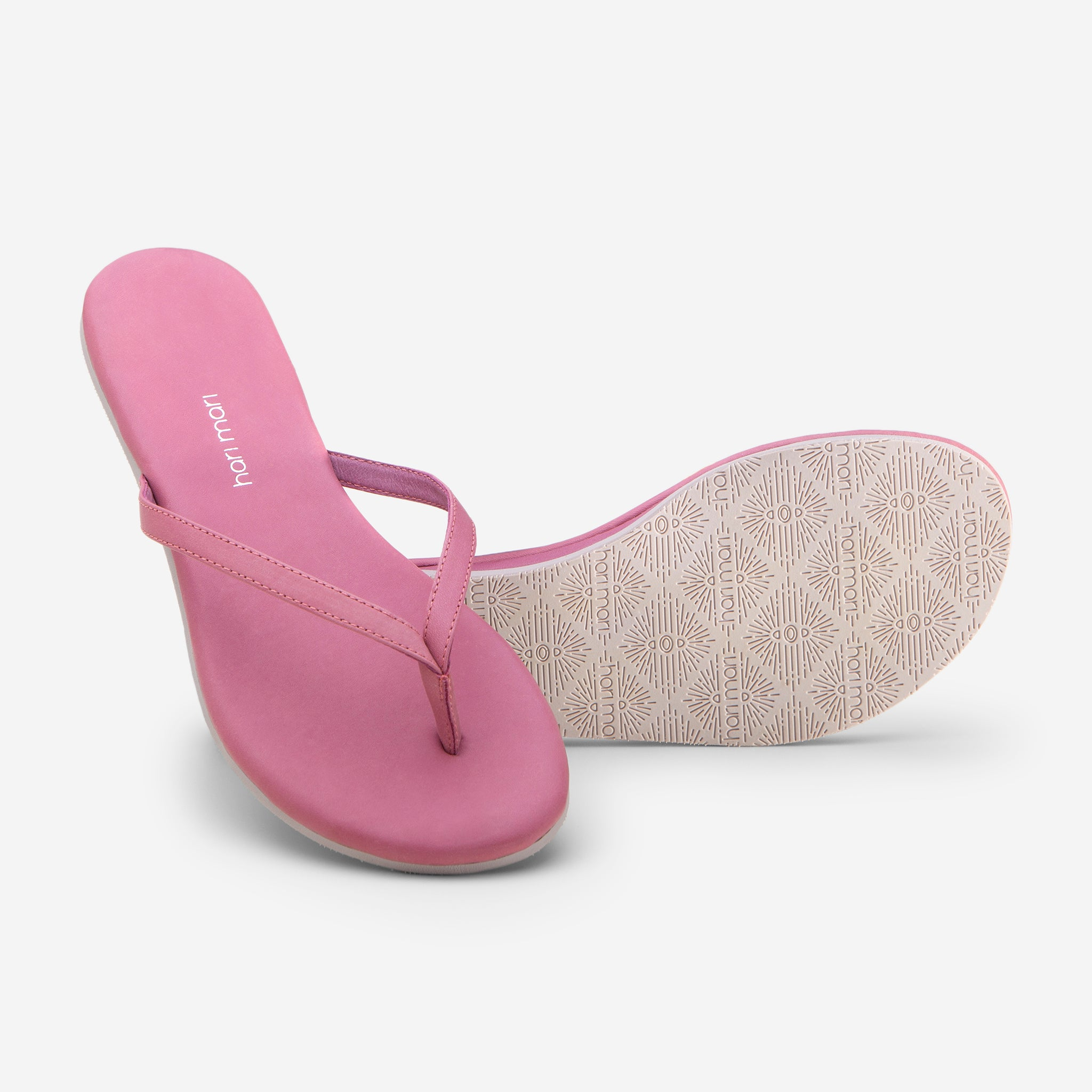 Hari Mari Women's The Mari Flip Flop in Rose showing flip flop and bottom of flip flop rubber outsole on white background