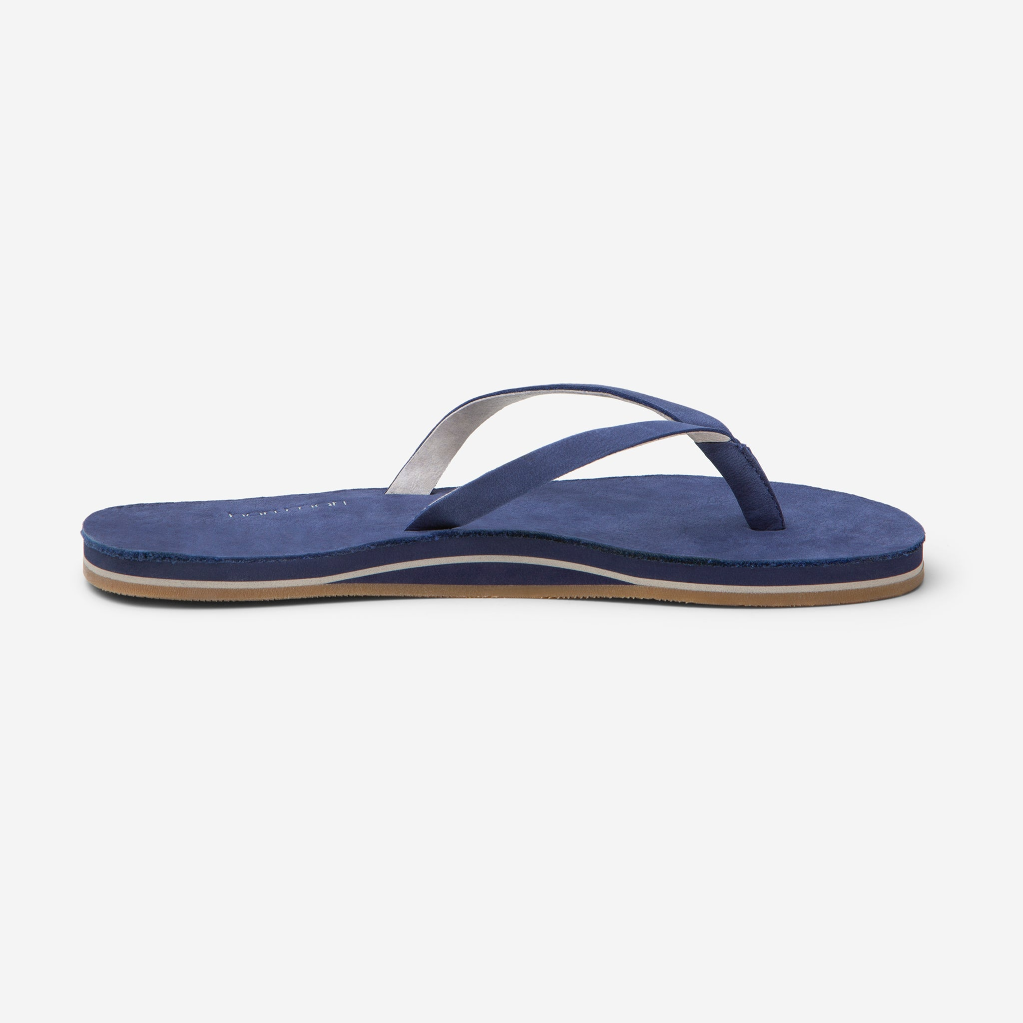 side profile of Hari Mari Women's Meadows Flip Flops in Navy on white background
