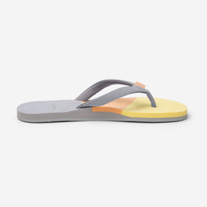 side profile of Hari Mari Women's meadows asana flip flops in light grey/multi color on white background