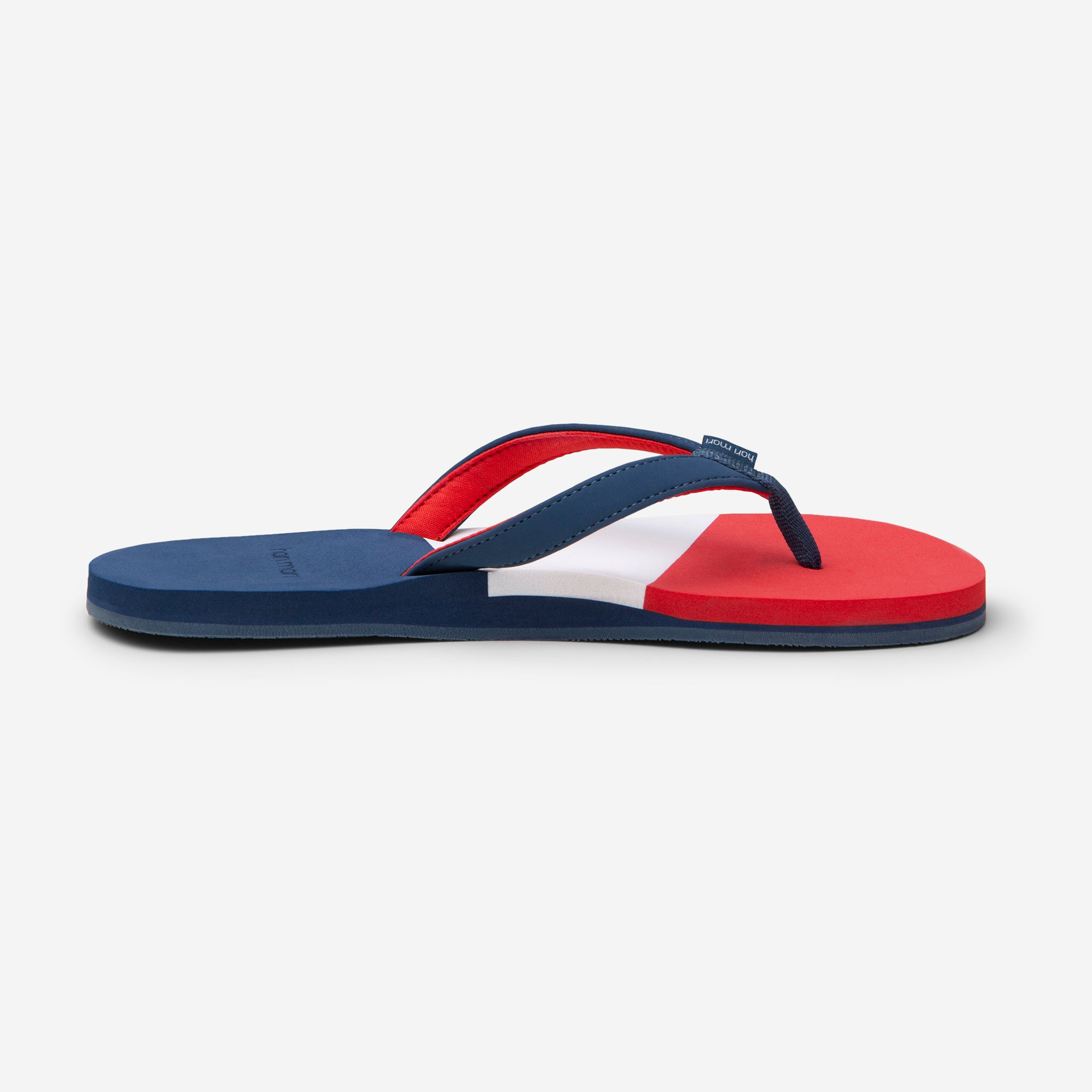 side profile of Hari Mari Women's Meadows Asana Flip Flops in Navy/Red/Lily on white background