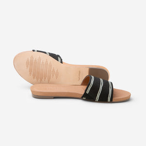 Hari Mari Women's Sydney Woven Sandal in Black showing sandal and bottom of sandal genuine leather outsole on white background