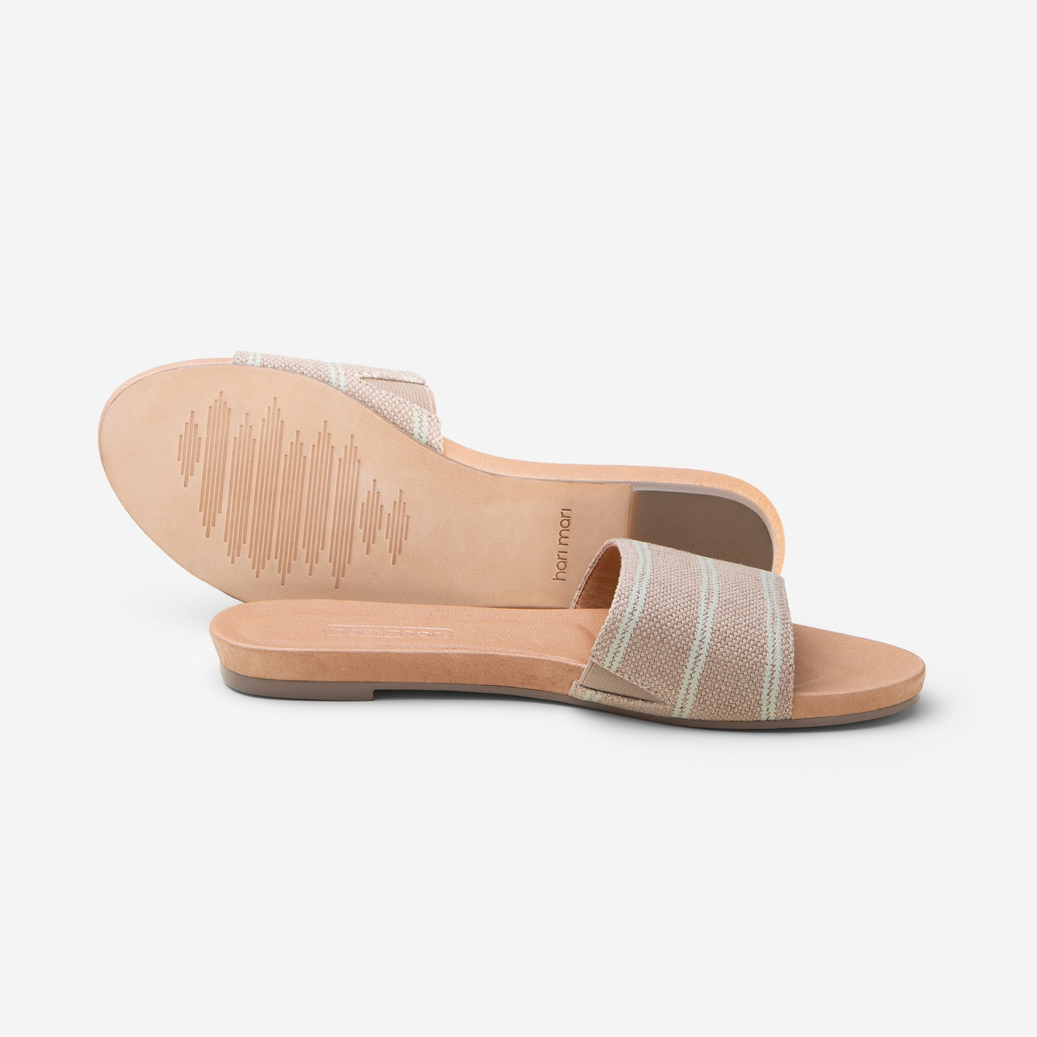 Hari Mari Sydney Woven Sandal in Natural on white background showing sandal and bottom of sandal genuine leather outsole