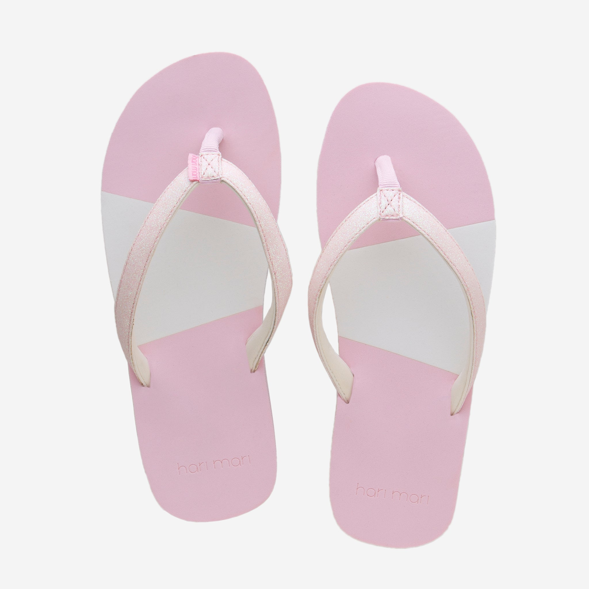 Hari Mari Youth Meadows Asana Glitter flip flops in Pink on white background