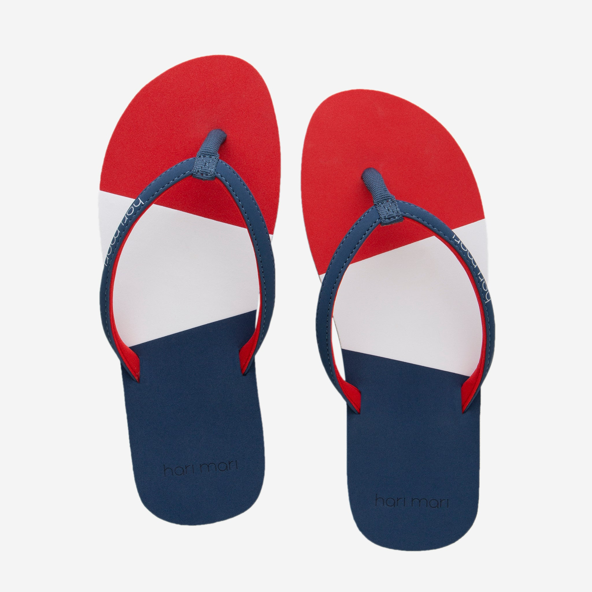 Hari Mari Meadows Asana Youth Flip Flops in red white and navy on white background