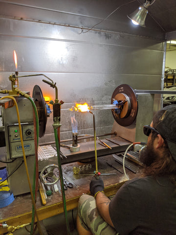 Glass blowing creating bowls with magnets
