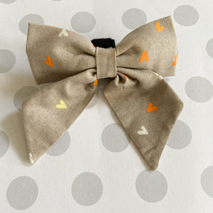 Gray with bright orange and yellow hearts