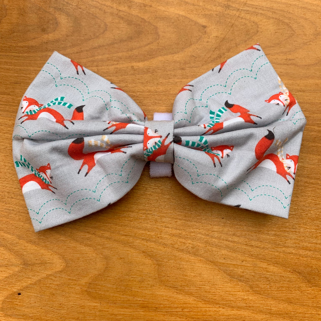 Foxes in scarves on grey bow tie